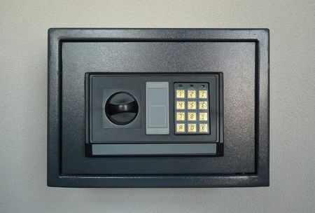 keypad: Small home or hotel wall safe with keypad, closed door