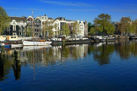 amstel: Amsterdam houses and houseboats on Amstel river Stock Photo