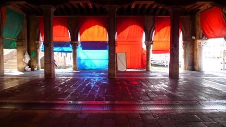 city fish market: Colorful curtains under the colonnade of the fish market near Rialto bridge in Venice Editorial