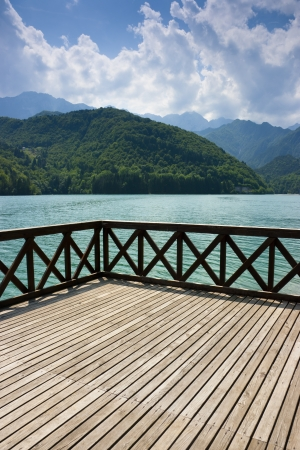 banister: Terrace on the green waters of Barcis lake, Pordenone, Italy