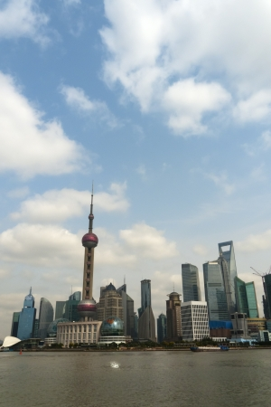Shanghai Pudong as seen from the Bund. Day vertical view from march 2012.
