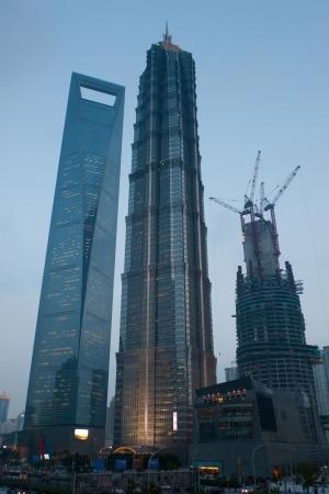 financial world: Skyscraper beign build near Shanghai World Financial Center and Jin Mao Tower in Pudong, Shanghai Editorial