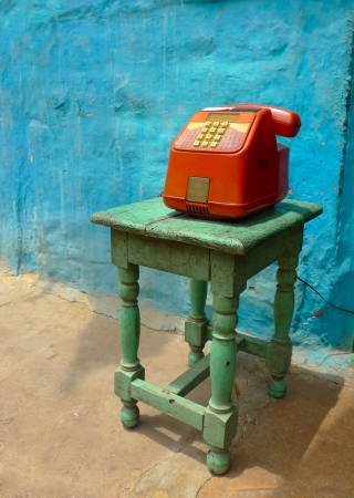 Colorful public phone on a stool in a street in Jodhpur, Rajasthan, India photo