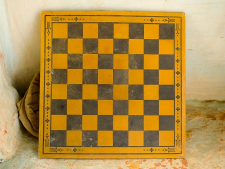 Old worn checkerboard against a wall in Jodhpur, Rajasthan, India photo