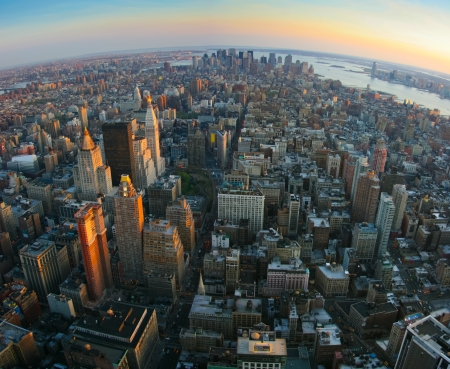 new horizons: Aerial panoramic fisheye view over lower Manhattan, New York from Empire State building top at sunset