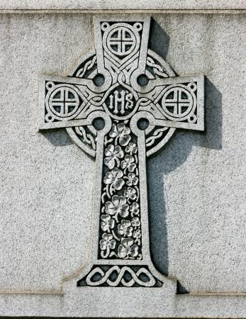 Celtic Cross With Shamrock White marble celtic cross on a