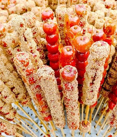 Sugar-Coated Haws on a stick (Bing Tang Hu Lu) Stock Photo - 17591959