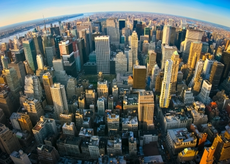 Fisheye aerial panoramic view over upper Manhattan from Empire State building top, New York. Sunset of a clean, sunny day with exceptional visibility. Stock Photo