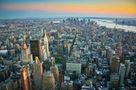 new horizon: Aerial view over lower Manhattan, New York from Empire State building top at dusk Stock Photo