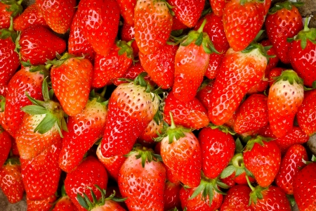 rapidly: Strawberries on sale in a street market in Shanghai, China. Chinas strawberry production is large and growing rapidly. Stock Photo