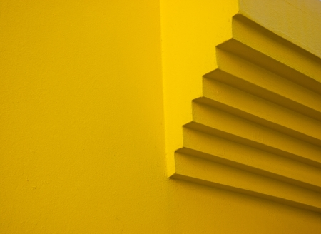 segmented: Detail of a segmented chimneys end on a yellow wall in Caorle, Veneto, Italy Stock Photo