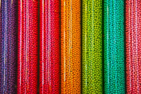 candy shop: Transparent plastic tubes full of thousands of colorful candies Stock Photo