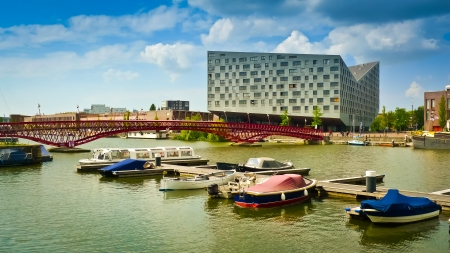 urban redevelopment: Modern buildings and boats in Amsterdams Eastern Docklands, Netherlands