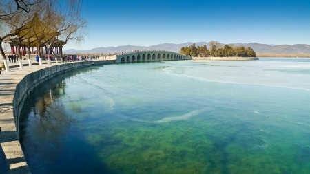 summer palace: The Seventeen Arch Bridge over Kunming Lake in the Summer Palace complex, Beijing, China. Stock Photo