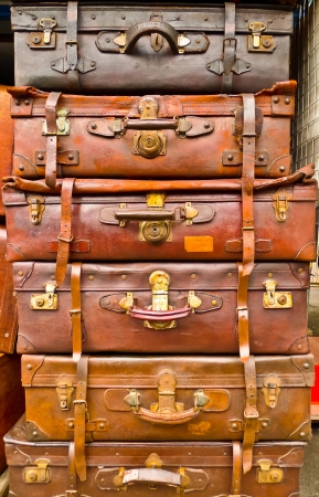 Vintage battered leather suitcases stacked vertically Stock Photo - 18910338