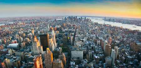 Aerial panoramic wide angle view over lower Manhattan, New York from Empire State building top at sunset in 2007