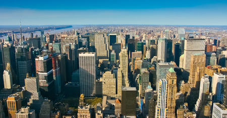 bryant park: Aerial panoramic view over upper Manhattan, New York. Sunset of a clean, sunny day with exceptional visibility.