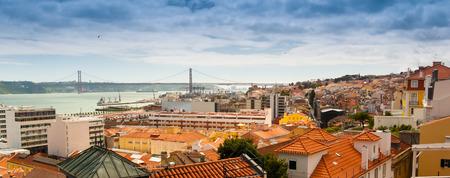 Bairro Alto and April 25th bridge as seen from the Miradouro (Belvedere) de Santa Caterina, Lisbon, Portugal