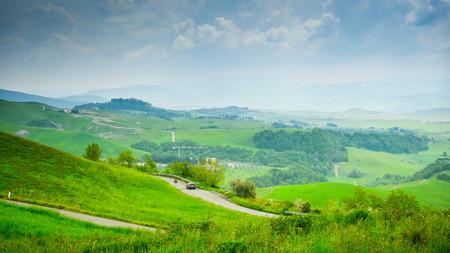 Hills in the haze surrounding Volterra, Tuscany, Italy Standard-Bild