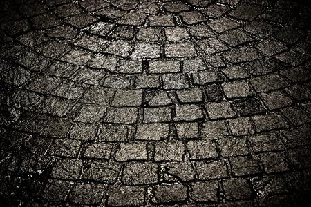 Dark wet cobblestone background Standard-Bild