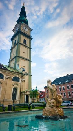 St Egid Kirche und Brunnen in Klagenfurt, Österreich Lizenzfreie Bilder