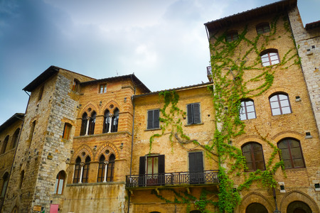 Close up of traditional buildings in the square of San Gimignano, Tuscany, Italy
