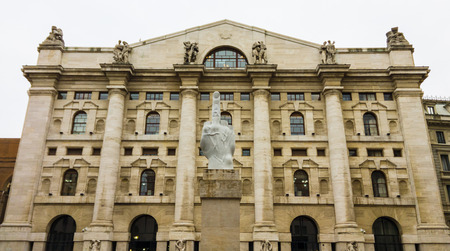 Milan, Italy - March 17, 2015: Italian stock exchange building in Piazza Affari, Milan, featuring the controversial sculpture L.O.V.E. by Maurizio Cattelan. Editorial