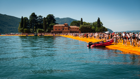 SENSOLE, ITALY - JUNE 27: Christos Floating Piers installation near Isola  di San Paolo on June 27th, 2016. The bulgarian artists project connects Montisola and San Paolo island to the mainland using temporary floating walkways.