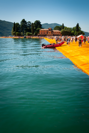 isola: SENSOLE, ITALY - JUNE 27: Christos Floating Piers installation near Isola  di San Paolo on June 27th, 2016. The bulgarian artists project connects Montisola and San Paolo island to the mainland. Editorial