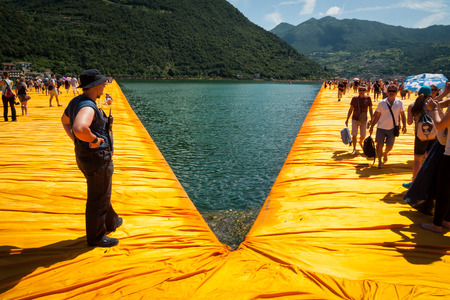 SENSOLE, ITALY - JUNE 27: Christos Floating Piers security staff on June 27th, 2016. The bulgarian artists project connects Montisola and San Paolo island to the mainland. Editorial