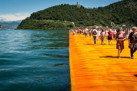 SENSOLE, ITALY - JUNE 27: Christos Floating Piers walkway edge on June 27th, 2016. The temporary floating walkways are covered with 100.000 sq meters of yellow fabric.