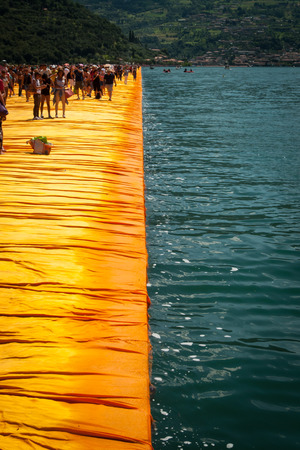 SENSOLE, ITALY - JUNE 27: Christos Floating Piers longest walkway on June 27th, 2016. The temporary floating walkways are covered with 100.000 sq meters of yellow fabric.