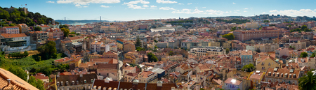 Wide panoramic view over Baixa and Castelo de Sao Jorge from Alfama, Lisbon, Portugal
