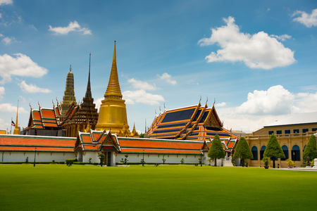 The Temple of the Emerald Buddha seen across a lawn inside the Grand Palace complex in Bangkok, Thailand