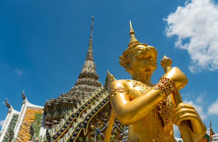 A golden mythical thai warrior guarding the temples inside the Grand Palace complex in Bangkok, Thailand