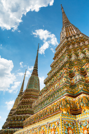 Colorful chedi against a blue sky in Wat Pho or Temple of the reclining Buddha, Bangkok, Thailand Lizenzfreie Bilder