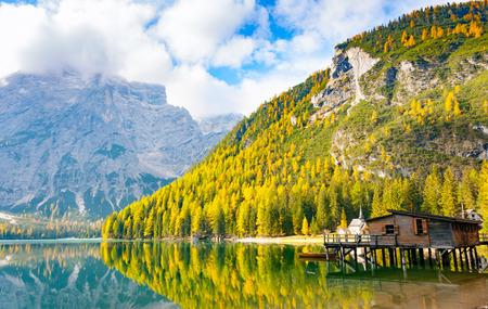 Hut on Prags lake and Dolomites in autumn, Trentino Alto Adige, Italy
