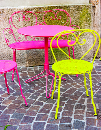 Fluorescent cafe table and chairs in the streets of Innsbruck, Tyrol, Austria