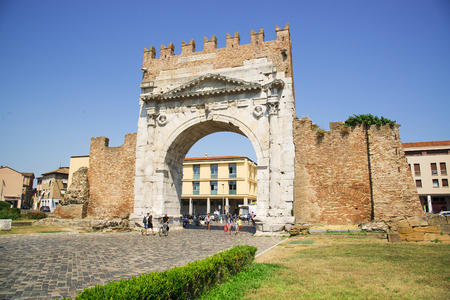 Rimini, Italy - June 21, 2017: the triumphal arch of Augustus in the central part of Rimini, a resort town in Italy