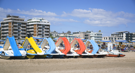 adriatico: Emilia-Romagna, Italy. - June 18, 2017: boats and people on the beach.