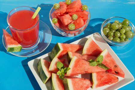 Cold watermelon juice and sliced watermelon 写真素材