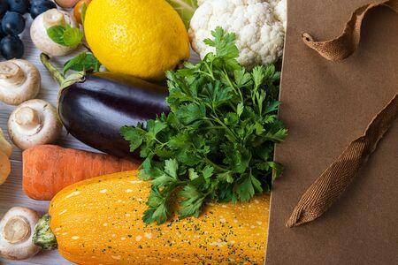 Bag of fresh vegetables on a white wooden table Stock fotó - 131943917