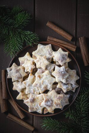 Christmas background with homemade cookies, cinnamon and spruce. Stock fotó