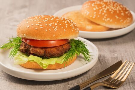 hamburger on a gray wooden table