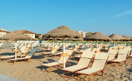 Umbrellas and deck chairs on the beach in the morning of Rimini in Italy 版權商用圖片