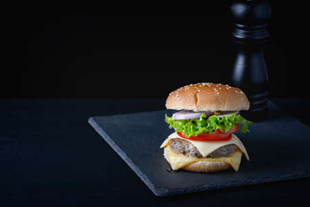 Close-up home made beef burger on wooden table Foto de archivo