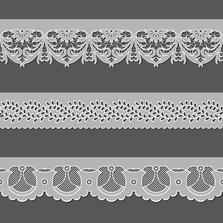 cutwork: set of ribbons embroidered cutwork on a gray background
