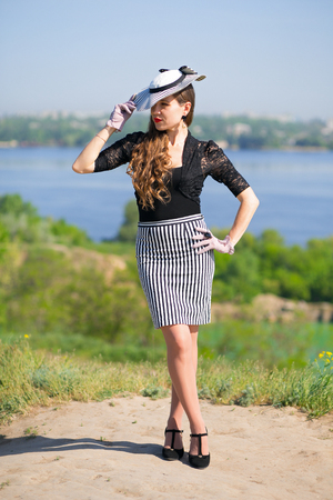 Retro style girl in a striped hat