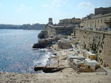 lazarus: View of Grand Harbour, Siege Bell Memorial and Lower Barrakka Gardens from St. Lazarus Bastion, Valletta, Malta, Europe Stock Photo