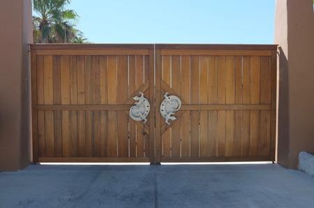 baja california: Wooden gate with gecko handles, San Jose del Cabo, Baja California Sur, Mexico Stock Photo